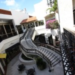 The Grand Staircase is the architectural centerpiece of Palm Beach's Worth Avenue Esplanade Shopping Area. Built by Rapp Construction Company to replace the existing escalator, it had to be crafted to demanding standards while the surrounding businesses remained open.